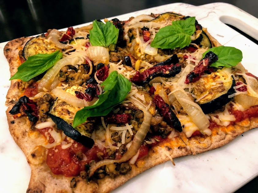 "Tempeh ""Sausage"", Caramelized Onion, Roasted Eggplant, and Sundried Tomato Pizza on Whole Wheat Lavash"